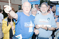 Ben Cohen (right) and Larry Greenfield, co-founders of Ben & Jerry's ice cream, join supporters of Democratic presidential candidate and Vermont senator Bernie Sanders as they take part in the Labor Day Parade in Milford, New Hampshire, on Mon., September 2, 2019. Candidates Bernie Sanders and Vermin Supreme were the only candidates who marched in the parade this year.