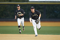 Bobby Seymour (3) of the Wake Forest Demon Deacons flips the ball towards first base during the game against the Notre Dame Fighting Irish at David F. Couch Ballpark on March 10, 2019 in  Winston-Salem, North Carolina. The Fighting Irish defeated the Demon Deacons 8-7 in 10 innings in game two of a double-header. (Brian Westerholt/Four Seam Images)
