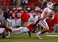 Wisconsin Badgers quarterback Joel Stave (2) evades Ohio State Buckeyes defensive lineman Noah Spence (8) during Saturday's NCAA Division I football game at Ohio Stadium in Columbus on September 28, 2013. (Barbara J. Perenic/Columbus Dispatch)
