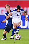 Dostonbek Khamdamov of Uzbekistan (R) fights for the ball with Sasaki Sho of Japan (L) during the AFC Asian Cup UAE 2019 Group F match between Japan (JPN) and Uzbekistan (UZB) at Khalifa Bin Zayed Stadium on 17 January 2019 in Al Ain, United Arab Emirates. Photo by Marcio Rodrigo Machado / Power Sport Images