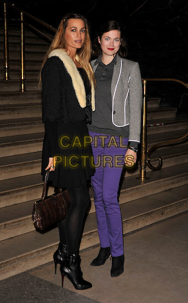"YASMIN LE BON & JASMINE GUINNESS .The ""Darwin"" exhibition VIP Preview, Natural History Museum, London, England, November 11th 2008..full length purple trousers jeans grey gray jacket top black shoes dress cream fur collar coat dress bag  ankle boots  .CAP/CAN.©Can Nguyen/Capital Pictures"