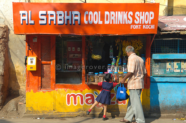 India, Kerala, Fort Cochin (Cochi, Kochi) 2005. Little girl at small shop.