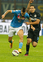 Marek Hamsik   Hernanes during the Italian serie A   soccer match between SSC Napoli and Inter    at  the San Siro    stadium in Milan  Italy , Octoberr 19 , 2014