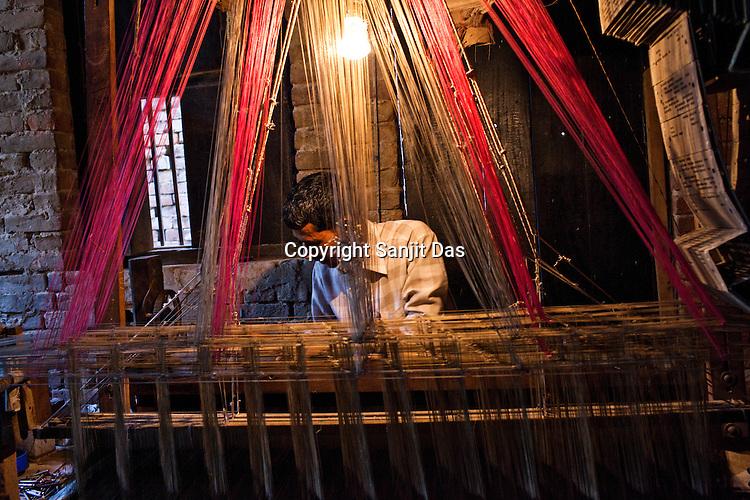 Md. Naim is one of the few muslim weavers using traditional looms to weave famous Benaresi saris in his workspace in Gazi Sadullahpura Bade Bazaar in Varanasi in Uttar Pradesh, India. Photograph: Sanjit Das/Panos