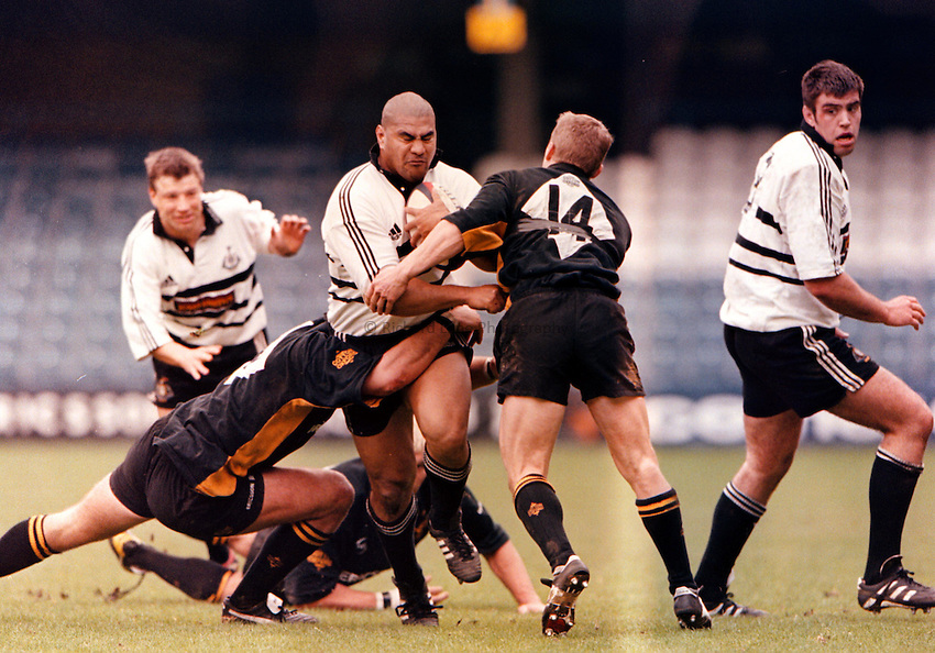 Photo: Richard Lane.Wasps v Newcastle 18.04.99.In the preview for the Tetley Bitter Cup Final next month Inga Tuigamala test the Wasps defence. Wasps are looking to tempt the player back to London next season. Rob Andrew behind in support and Wasps players (l-r) 8-Joe Worsley, 4-Simon Shaw, 14-Josh Lewsey. Newcastle 8 is Ross Beatie
