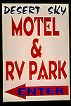 Illuminated sign for Desert Sky Motel and RV Park, Yucca Valley, California