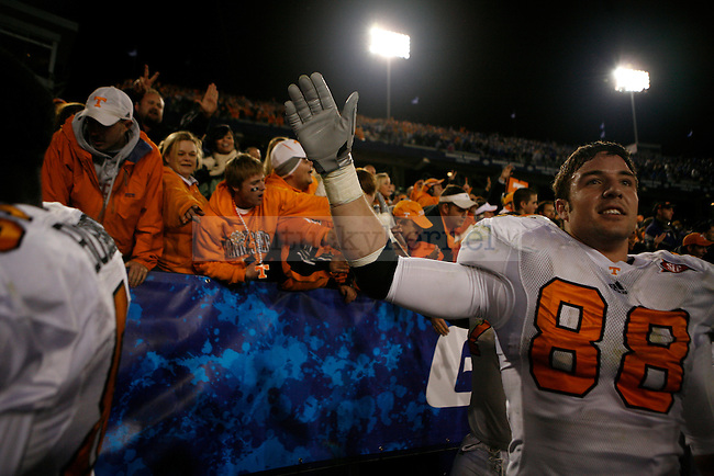 Tennessee's tight end Luke Stocker celebrates with fans after their win over UK at Commonwealth Stadium on Saturday, Nov. 28, 2009. The Volunteers won 30-24 in an overtime game with the Wildcats. Photo by Adam Wolffbrandt | Staff