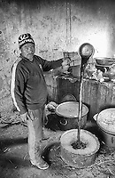 A cook prepares a vat of tea inside the Hemis Monastery.