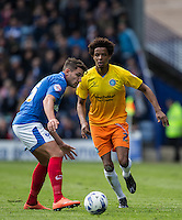 Sido Jombati of Wycombe Wanderers takes on Gareth Evans of Portsmouth during the Sky Bet League 2 match between Portsmouth and Wycombe Wanderers at Fratton Park, Portsmouth, England on 23 April 2016. Photo by Andy Rowland.