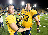 Jordan Rigsbee of California celebrates with Steffan Mos of California after CAL won the game against UCLA at Memorial Stadium in Berkeley, California on October 6th, 2012.  California defeated UCLA, 43-17.