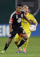 WASHINGTON, DC - OCTOBER 20, 2012:  Lionard Pajoy (26) of D.C United shields the ball from Chris Birchall (8) of the Columbus Crew during an MLS match at RFK Stadium in Washington D.C. on October 20. D.C United won 3-2.