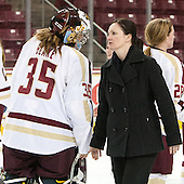 Taylor Blake (BC - 35), Linda Lundrigan (NU - Associate Head Coach), Kate Leary (BC - 28) - The Boston College Eagles celebrate winning the 2014 Beanpot championship on Tuesday, February 11, 2014, at Kelley Rink in Conte Forum in Chestnut Hill, Massachusetts.