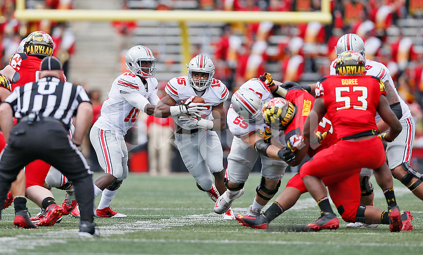 Ohio State Buckeyes quarterback J.T. Barrett (16) hands off to Ohio State Buckeyes running back Ezekiel Elliott (15) for a gain in the second half at Byrd Stadium on October 4, 2014.  (Chris Russell/Dispatch Photo)
