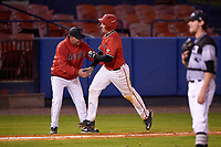 Ball State Cardinals first baseman Caleb Stayton (34) is congratulated by head coach Rich Maloney (2) after hitting a home run during a game against the Wisconsin-Milwaukee Panthers on February 26, 2016 at Chain of Lakes Stadium in Winter Haven, Florida.  Ball State defeated Wisconsin-Milwaukee 11-5.  (Mike Janes/Four Seam Images)