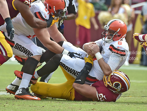 Cleveland Browns quarterback Cody Kessler (6) is sacked by Washington Redskins defensive end Trent Murphy (93) in second quarter action against the Washington Redskins at FedEx Field in Landover, Maryland on October 2, 2016.<br /> Credit: Ron Sachs / CNP