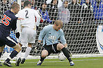 13 December 2009: Akron goalkeeper David Meves (24) reacts to a shot off the near post as Virginia's Will Bates (25) and Akron's Zarek Valentin (2) look on. The University of Virginia Cavaliers defeated the University of Akron Zips 3-2 in penalty kicks following a 0-0 overtime tie at WakeMed Soccer Stadium in Cary, North Carolina in the NCAA Division I Men's College Cup Championship game.