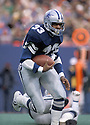 Dallas Cowboys Tony Dorsett(33), in action during a game against the New York Giant on December 19, 1981 at The Meadowlands in East Rutherford, New Jersey.   The Giant beat the Cowboys in overtime 13-10