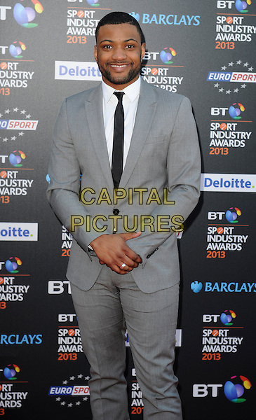 Jonathan 'JB' Gill of JLS.Attending the BT Sport Industry Awards at Battersea Evolution, London, England, UK, May 2nd 2013..half length smiling beard facial hair grey gray suit white shirt 3/4 .CAP/PP/GM.©Gary Mitchell/PP/Capital Pictures