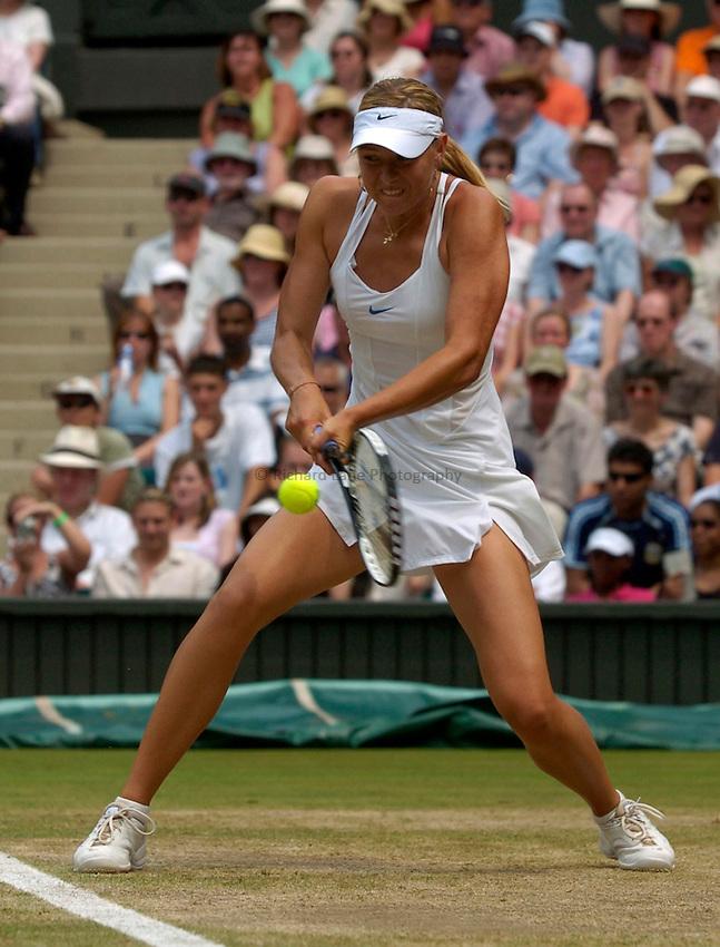 Photo: Richard Lane..Wimbledon Championships. 04/07/2006. .Maria Sharapova of Russia returns.
