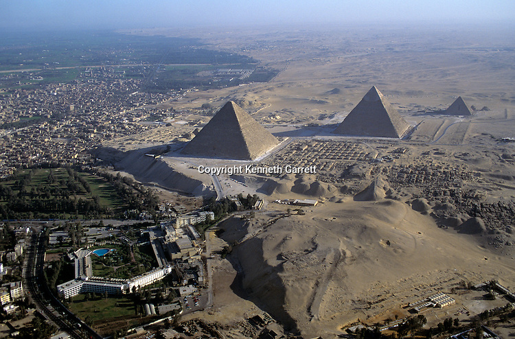 Egypt's Old Kingdom;Giza Plateau; Aerial of the Giza Pyramids (4th dynasty Pharaohs Khufu, Khafre, Menkaure) next to modern city of Cairo