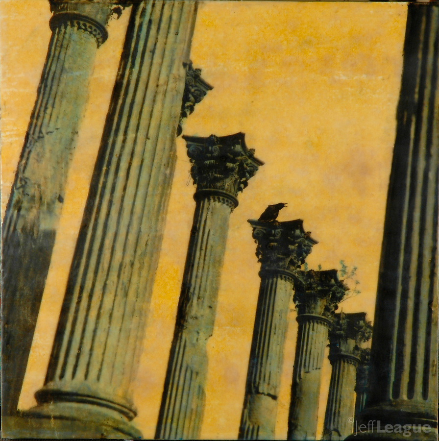Mixed media encaustic photo painting of architectural collage with crow on column in golden sunset sky.