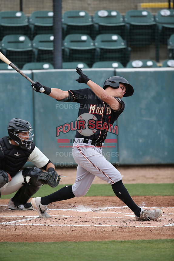 Jack Larsen (13) of the Modesto Nuts bats against the Visalia Rawhide at Recreation Ballpark on June 10, 2019 in Visalia, California. (Larry Goren/Four Seam Images)