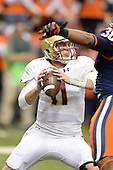 Boston College Eagles quarterback Chase Rettig (11) throws under pressure during a game against the Syracuse Orange at the Carrier Dome on November 30, 2013 in Syracuse, New York.  Syracuse defeated Boston College 34-31.  (Copyright Mike Janes Photography)