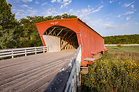 The Hogback Covered Bridge is a historic covered bridge near Winterset, Iowa. Named after a nearby limestone ridge, it was built in 1884 by Harvey P. Jones and George K. Foster over the North River on Douglas Township Road. The 106 feet  bridge was designed with a Town lattice truss system. It was built with steel pylons to support the main span.<br /> <br /> The Hogback Bridge was originally one of 19 covered bridges in Madison County; there are only six remaining covered bridges in the county. In 1992, the bridge was rehabilitated for the cost of $118,810 ($203,000 today). It was added to the National Register of Historic Places in 1976.