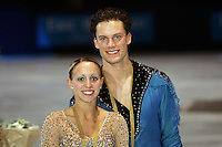 November 19, 2005; Paris, France; Figure skating stars VALERIE MARCOUX and CRAIG BUNTIN of Canada celebrate winning bronze in pairs at Trophee Eric Bompard, ISU Paris Grand Prix competition.  They are one of the pairs favorites for medals leading up to Torino 2006 Olympics.<br />