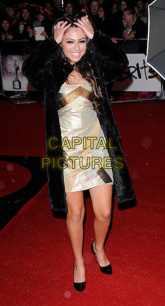GABRIELLA CILMI.Arrivals at the Brit Awards 2010 held at Earls Court, London, England..February 16th 2010 .Brits full length back fur coat hands on head in hair funny smiling  gold silver dress patent shoes christian louboutin .CAP/CAN.©Can Nguyen/Capital Pictures.