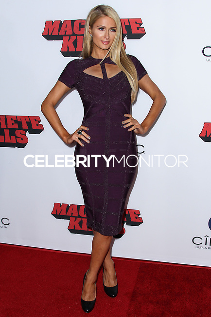 """LOS ANGELES, CA - OCTOBER 02: Paris Hilton arrives at the Premiere Of Open Road Films' """"Machete Kills"""" held at Regal Cinemas L.A. Live on October 2, 2013 in Los Angeles, California. (Photo by Xavier Collin/Celebrity Monitor)"""