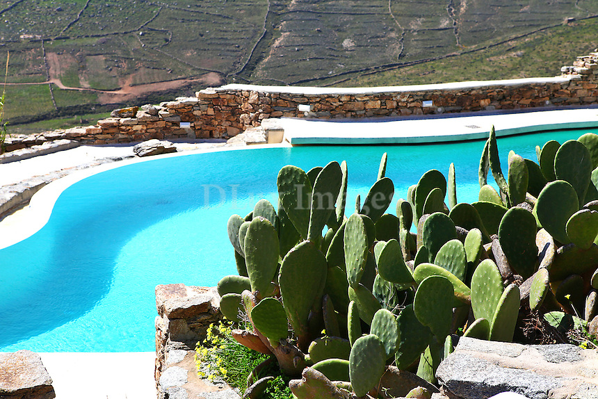luxury swimming pool..On the southeast side of Mykonos Island, Greece, an oasis of tranquility and seclusion is revealed. Faithful to the Cycladic aesthetic, Anna Veroutis' house stands out for its elegant décor, the individual style and its ?mix and match? aesthetics.