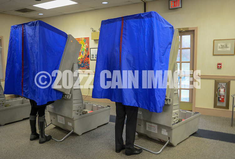 Scott Wallace (right), Democratic congressional candidate in the first district, and his wife Christy Wallace vote Tuesday, November 06, 2018 at Buckingham Township Building in Buckingham. [WILLIAM THOMAS CAIN / PHOTOJOURNALIST]