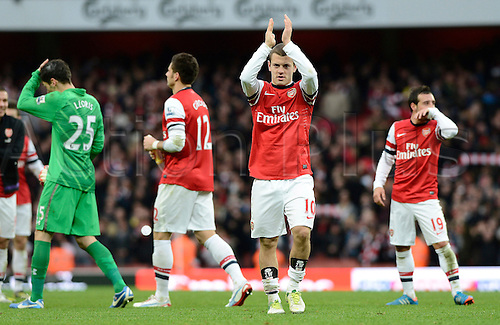 17.11.2012. London, England.  Jack Wilshere Of Arsenal  claps the home fans after beating Tottenham 5-2 in the Premier League game between Arsenal and Tottenham Hotspur from the Emirates Stadium.