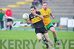 Brian Looney Crokes goes past Gerard Moynihan Gneeveguilla in their Castleisland Mart club Championship game in Killarney on Saturday night