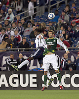New England Revolution midfielder Shalrie Joseph (21) and Portland Timbers defender Eric Brunner (5) battle for head ball. In a Major League Soccer (MLS) match, the New England Revolution tied the Portland Timbers, 1-1, at Gillette Stadium on April 2, 2011.