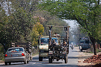 Indian workers travel in brightly coloured truck in Agra, Uttar Pradesh, India