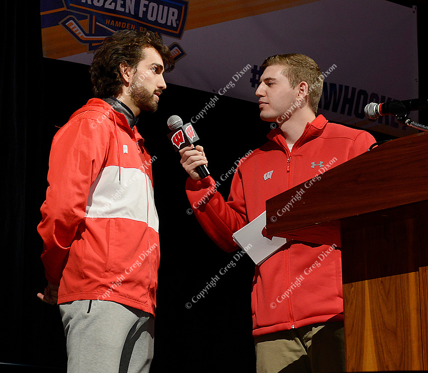 Wisconsin's Morgan McDonald, 2019 NCAA Indoor Track and Field men's national title champion in the 3000- and 5000-meter talks to Voice of Wisconsin Women's Hockey, Reid Magnum, during the NCAA championship awards ceremony on Monday, 3/25/19, at the Kohl Center in Madison, Wisconsin