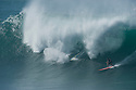 Shane Dorian (HAW) and Makua Rothman (HAW) during the Quiksilver Eddie Aikau at Waimea Bay on the Northshore of Oahu in Hawaii