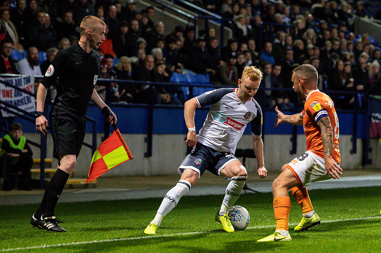 Bolton Wanderers' Ali Crawford competing with Blackpool's Jay Spearing (right) <br /> <br /> Photographer Andrew Kearns/CameraSport<br /> <br /> The EFL Sky Bet League One - Bolton Wanderers v Blackpool - Monday 7th October 2019 - University of Bolton Stadium - Bolton<br /> <br /> World Copyright © 2019 CameraSport. All rights reserved. 43 Linden Ave. Countesthorpe. Leicester. England. LE8 5PG - Tel: +44 (0) 116 277 4147 - admin@camerasport.com - www.camerasport.com