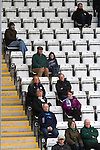 Visiting fans in the main stand watching the second-half action as Morecambe hosted Plymouth Argyle in a League 2 fixture at the Globe Arena. The stadium was opened in 2010 and replaced Morecambe's traditional home of Christie Park which had been their home since 1921, the year after their foundation. Plymouth won this fixture by 2-0 watched by 2,081 spectators, in a game delayed by 30 minutes due to traffic congestion affecting travelling Argyle fans.