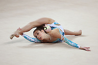 Rebecca Sereda (junior) of USA performs flexibility with ball at 2009 Pesaro World Cup on May 2, 2009 at Pesaro, Italy.  Photo by Tom Theobald.
