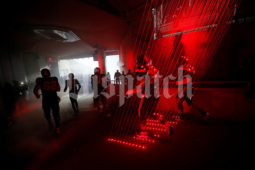 Ohio State Buckeyes players take the field through the tunnel prior to the NCAA football game against Penn State at Ohio Stadium in Columbus on Oct. 17, 2015. (Adam Cairns / The Columbus Dispatch)