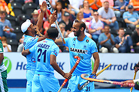 India's goalscorer Mandeep Singh is congratulated by Harjeet Singh and Ramandeep Singh to finish the scoring at 6-1 to India during the Hockey World League Semi-Final 5-8th place match between Pakistan and India at the Olympic Park, London, England on 24 June 2017. Photo by Steve McCarthy.