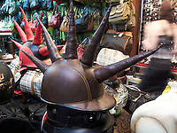 Mad Max style motorcycle helmets. In a shop in Kuta, Bali, Indonesia.<br /> July 2009.