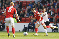Matty Cash of Nottingham Forest (C) challenged by Kyle Naughton of Swansea City (R) during the Sky Bet Championship match between Nottingham Forest and Swansea City at City Ground, Nottingham, England, UK. Saturday 30 March 2019