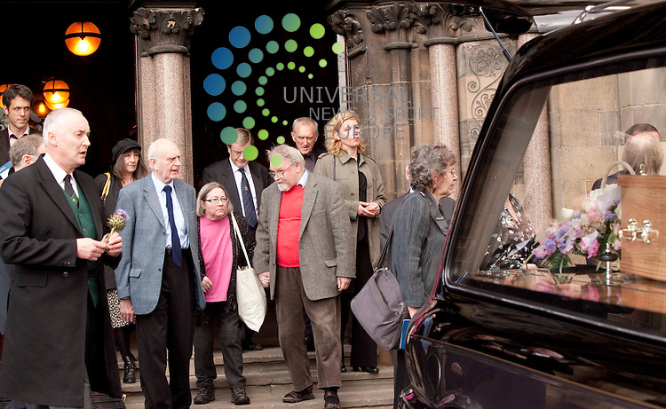 """Alasdair Gray red jumper with other mourners, Edwin Morgan,Funeral held for Scotland's first national poet, at Glasgow University- aged 90,Morgan was widely recognised as one of the foremost Scottish poets of the 20th Century and was the last remaining member of the """"Big Seven"""" poets of Hugh MacDiarmid, Robert Garioch, Norman MacCaig, Iain Crichton Smith, George Mackay Brown and Sorley MacLean..Picture: Johnny Mclauchlan/Universal News and Sport (Scotland). 26/08/10.."""