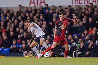 LONDON, ENGLAND - MARCH 04:   Andros Townsend of Tottenham Hotspur and Jack Cork of Swansea City  in action during the Premier League match between Tottenham Hotspur and Swansea City at White Hart Lane on March 4, 2015 in London, England.  (Photo by Athena Pictures )