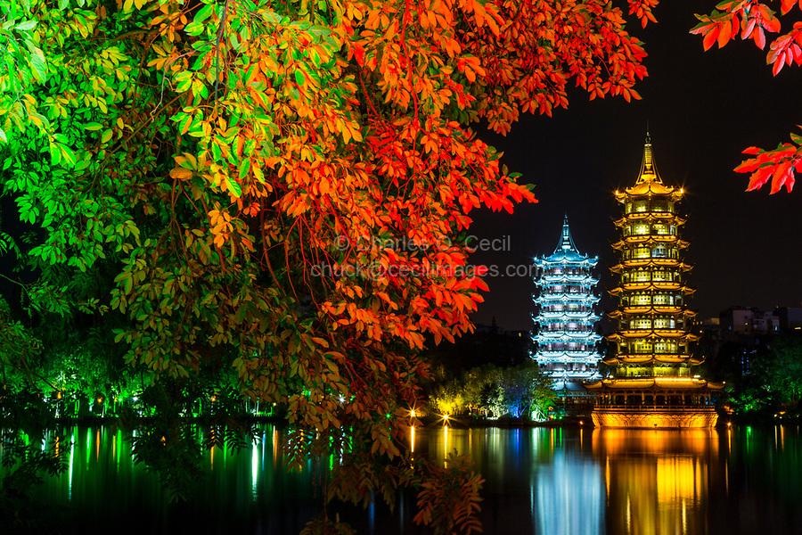 Guilin, China.  Sun and Moon Pagodas beside Shan Lake at Night.