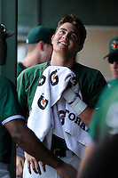 Third baseman Ryder Jones (15) of the Augusta GreenJackets laughs with teammates in the dugout before a game against the Greenville Drive on Sunday, July 13, 2014, at Fluor Field at the West End in Greenville, South Carolina. Jones was a second-round pick of the San Francisco Giants in the 2013 First-Year Player Draft. He is listed as the Giants' No. 15 prospect by Baseball America. Greenville won, 8-5. (Tom Priddy/Four Seam Images)